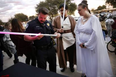 A light saber is inspected outside a Texas theater.